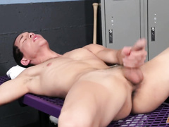 Gay is stroking cock and fingering shaved ass