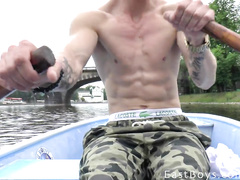 Twink is rowing oars to show off muscles to the camera