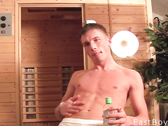 Brown haired twink is wanking off his big dick