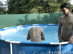 Some twink is filming two sexy gays having fun in the pool