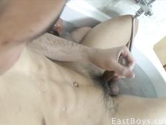 Charming sexy shaped twink enjoys handjob in bathtub