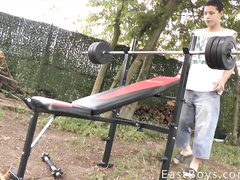 Cute gay guy lifts some weight and strokes his dick