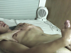 Smooth and slender shaped twink enjoys handjob from gay friend