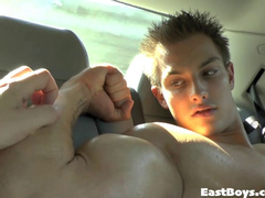 Teen gay is excitingly showing off his sexy body in the car