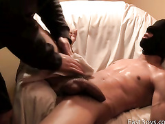 Twink in black mask is getting pleased with smooth handjob