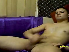 Young gay with smooth body is pleasantly jerking off