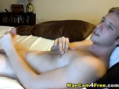 Cute blond twink is lying on the bed and getting hotly excited from hot gay porn