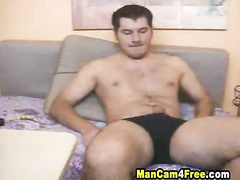 Pretty strong and sexy shaped twink enjoys masturbating dick