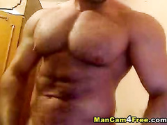 Handsome bodybuilder sexily poses and excitingly jerks off his dick
