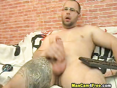 Nice young twink in sexy glasses pleasures masturbating on gay porn