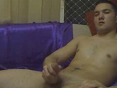 Young gay with smooth body is pleasantly masturbating his dick