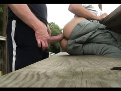 Twink in sitting on the bench and getting pleasantly fucked outdoors